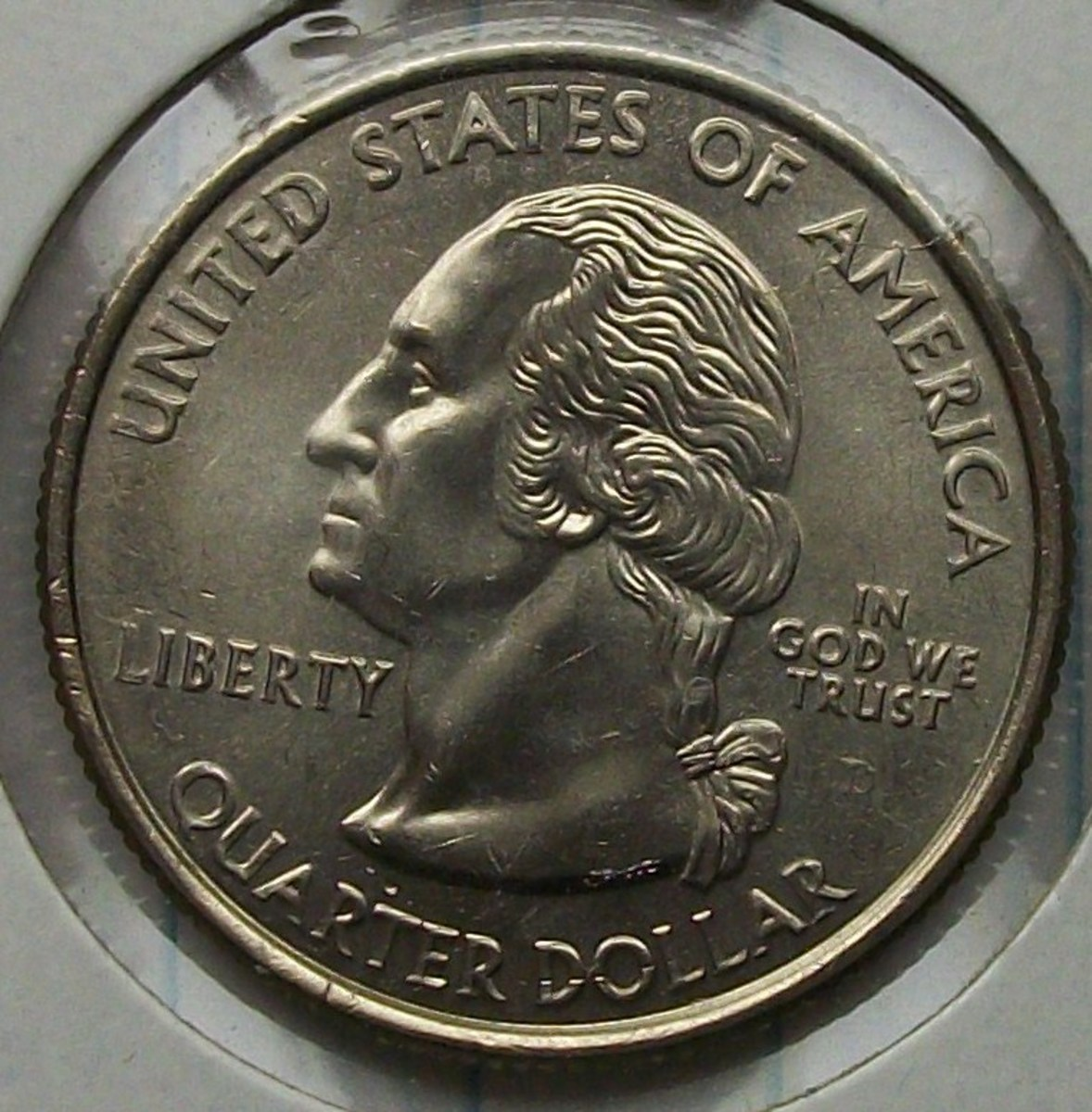 Obverse of the 2008D Oklahoma Statehood Quarter Fading D mint mark most likely caused by die polishing.