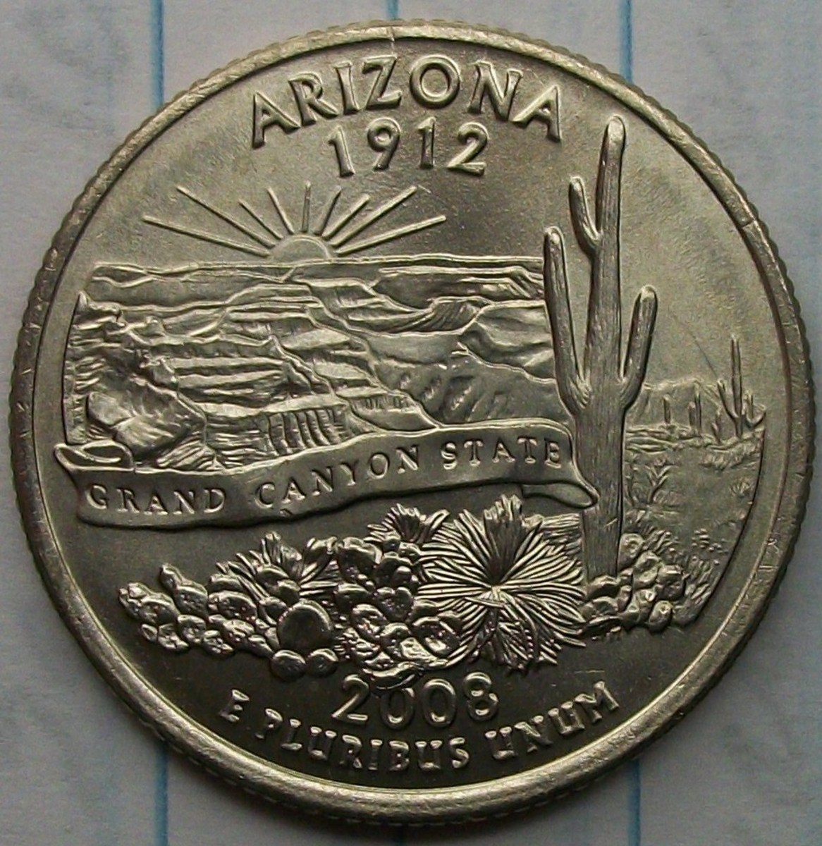 2008P Arizona 2 Leaf Error 1st leaf covering part of date. 2nd leaf covering part of the designer initials. There is a 2nd variety that only covers part of the designers initials.