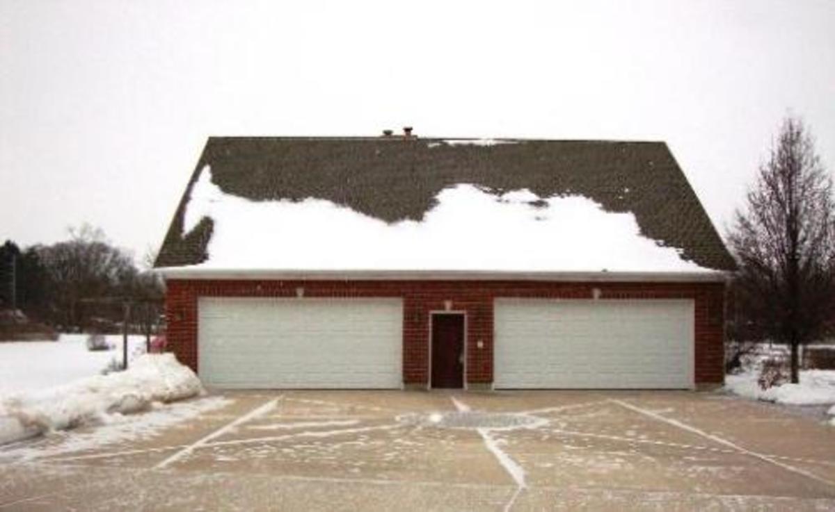 Basic four car garage with service door