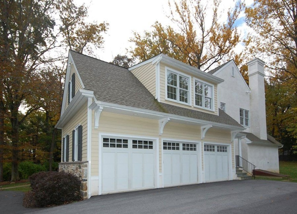 Home improvement coach house 3 car garage and more dream for Garage with dormers