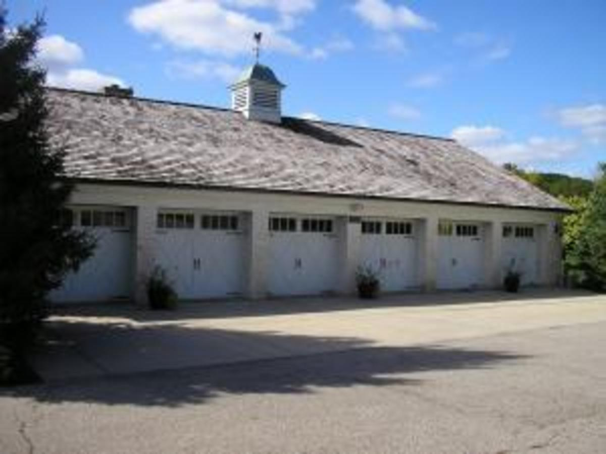 Stately 6 Car Garage Complete with Carriage Doors Cupola and Weather Vane