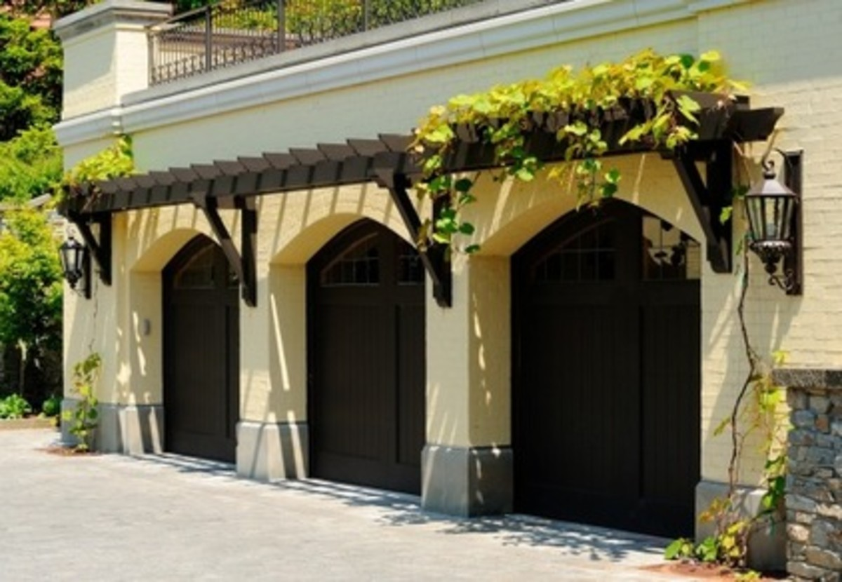 3 car garage with eyebrow pergola with wood door - elegant and understated beauty