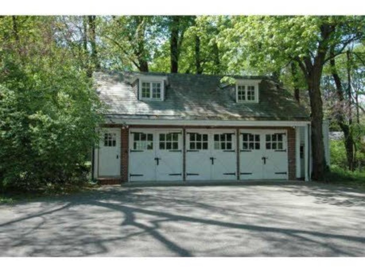 Classic Three Car Garage with all the architectural details - including dormer windows and garage windows will mullions and iron hardware