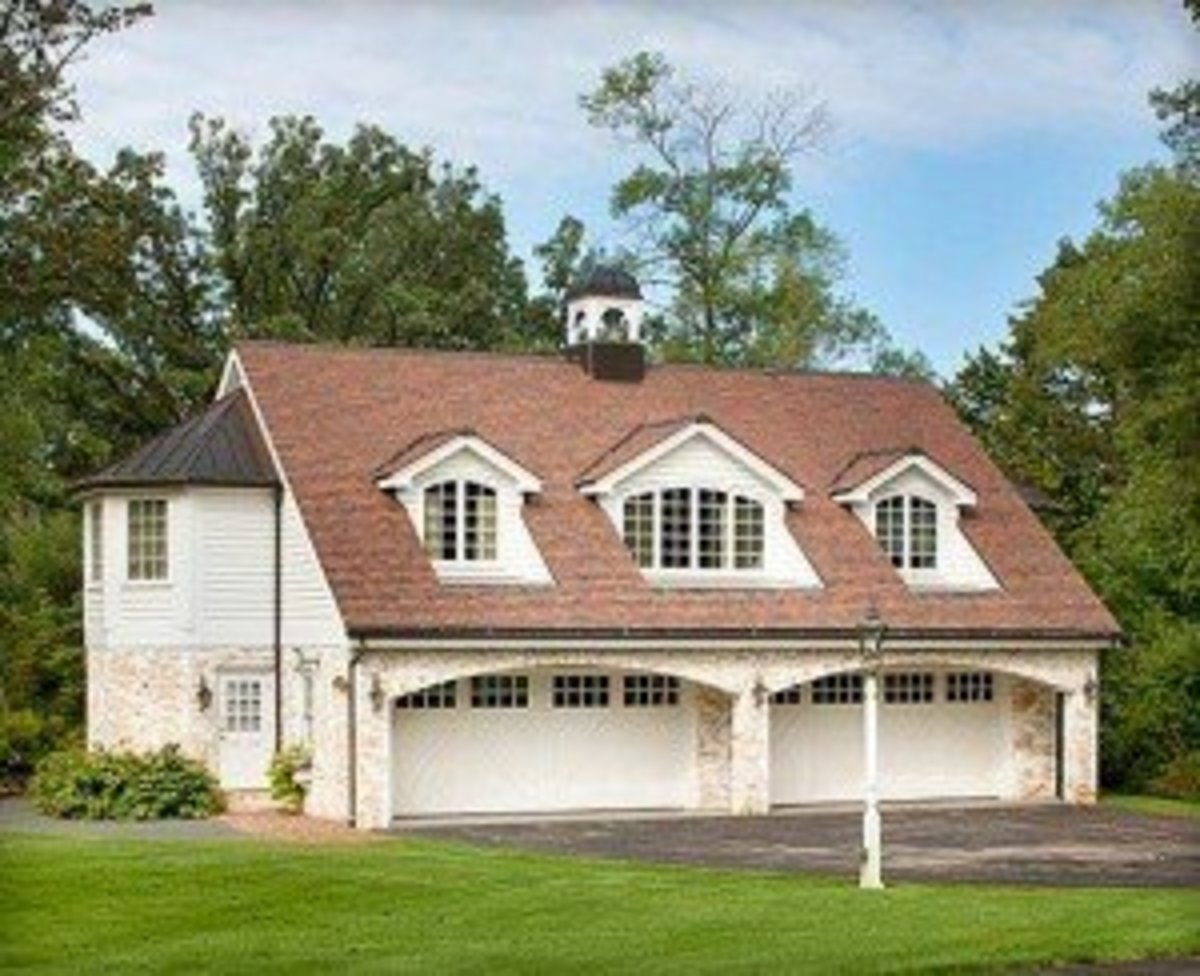 Four Car Garage with decorative arched windows in the dormers and cupola on top