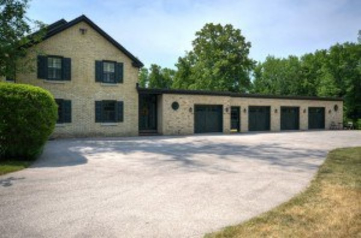 four car garage with flat roof and service door