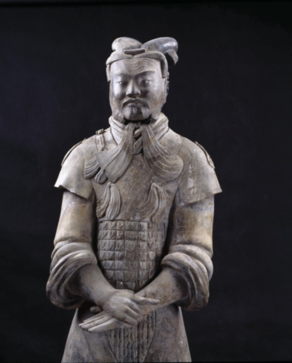 General does not wear armour.  He wears the kind of cap tied with tassels that hang under his chin.  A belt with a buckle secures the double-layered tunic Only nine generals have been found at the site.