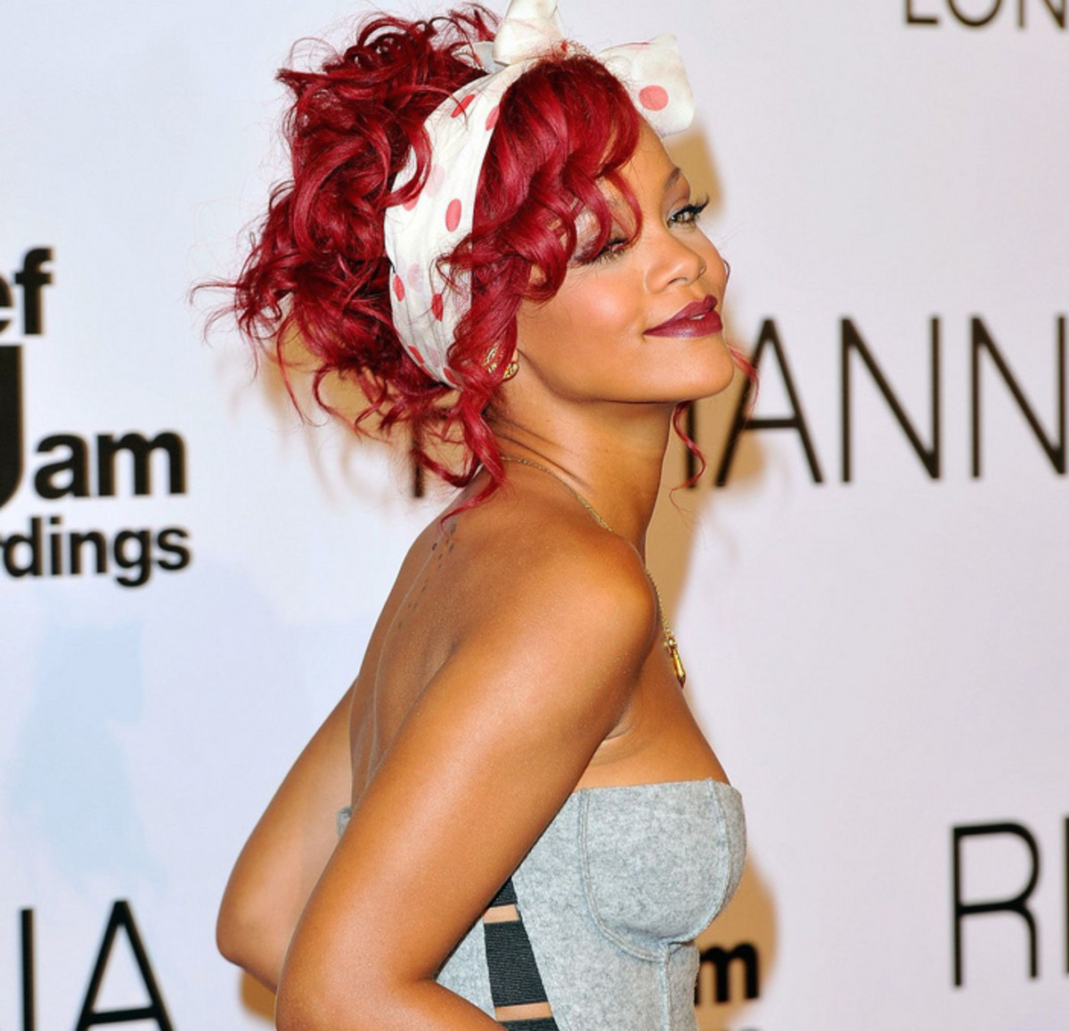 Rihanna with fire-engine-red hair.