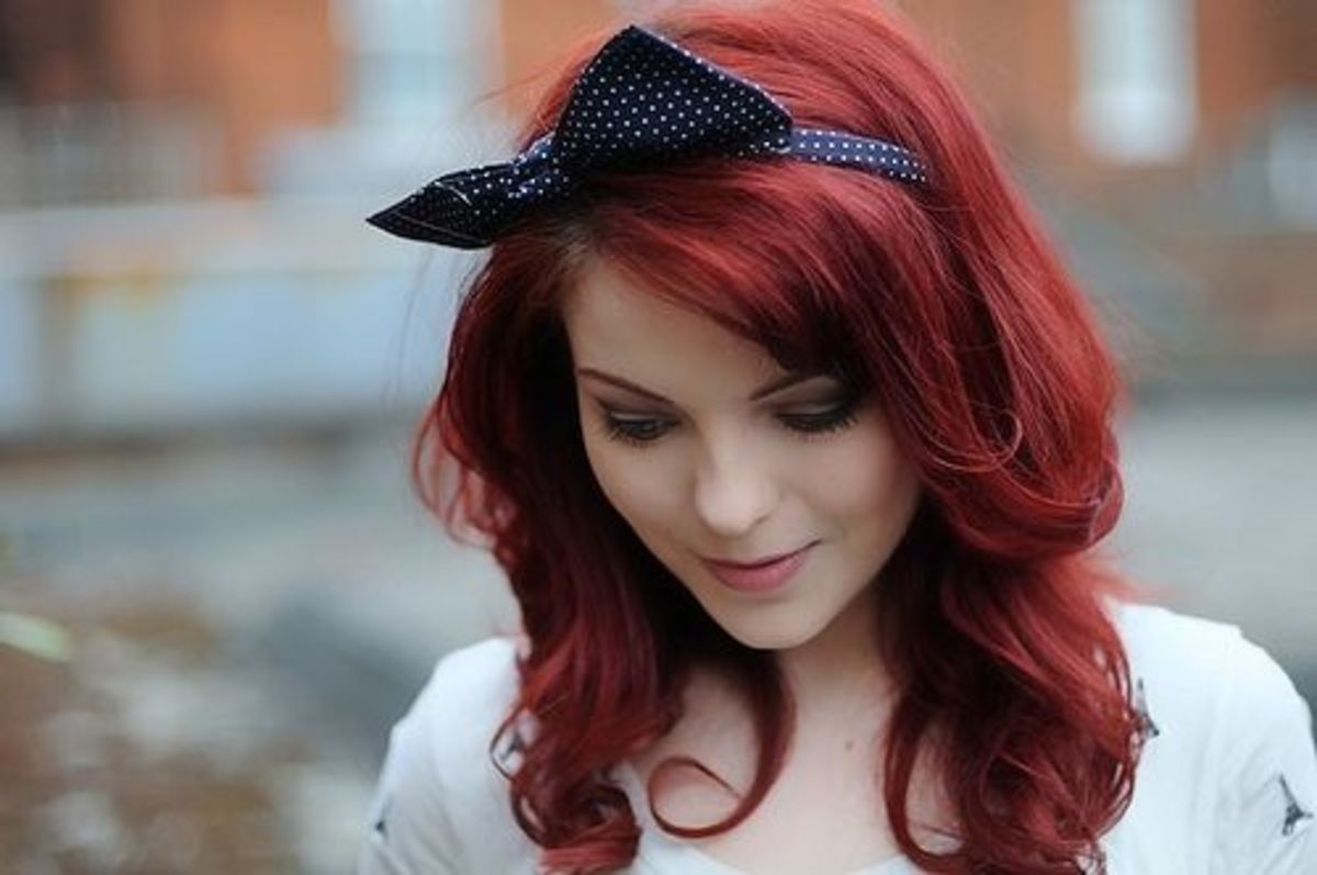 Bold curly red hair.