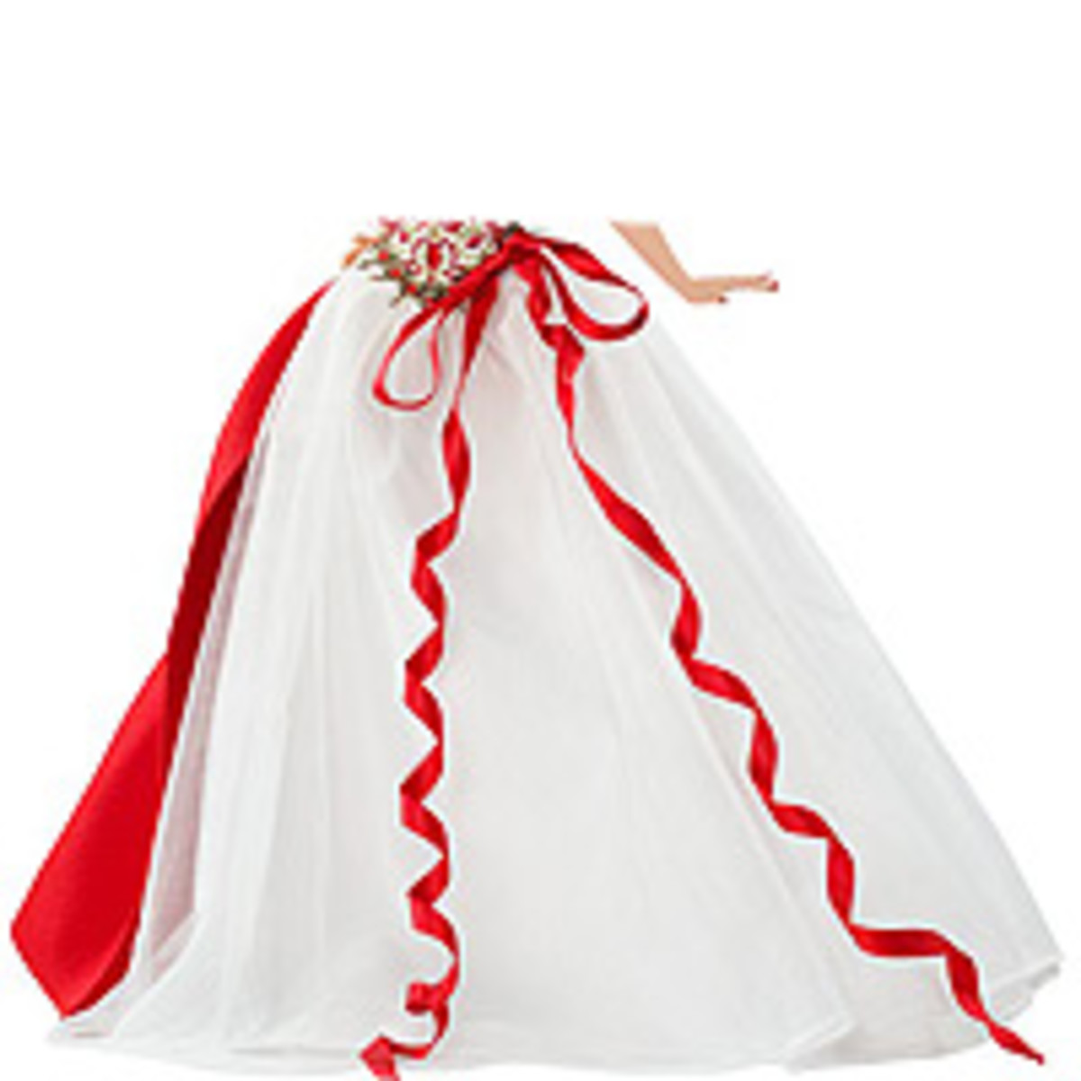 The red wrap and ribbon bow stand out against the snowy white skirt.