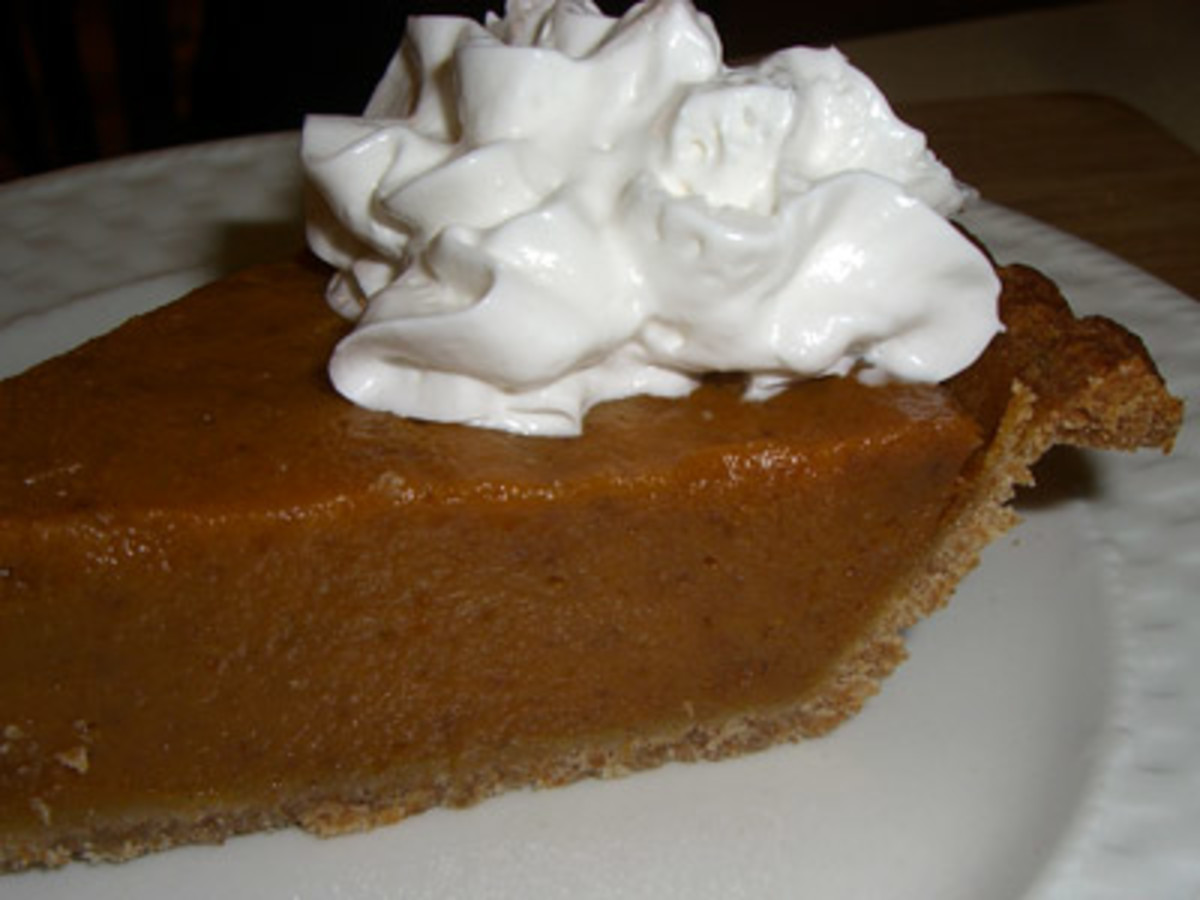Sliced pumpkin pie with whipped cream