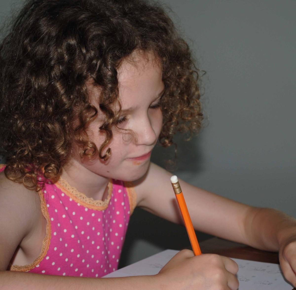 Child doing Kumon Math Worksheets