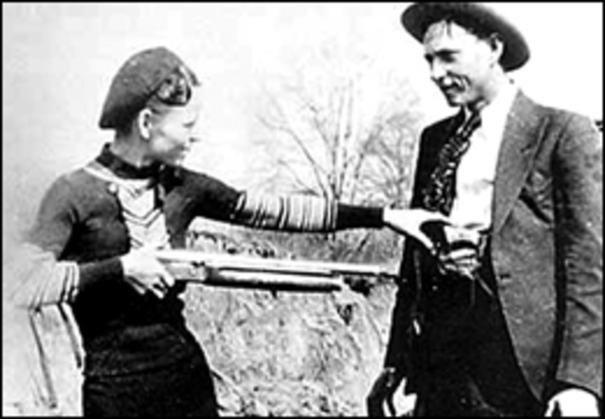 Bonnie holding Clyde at gunpoint - just for fun