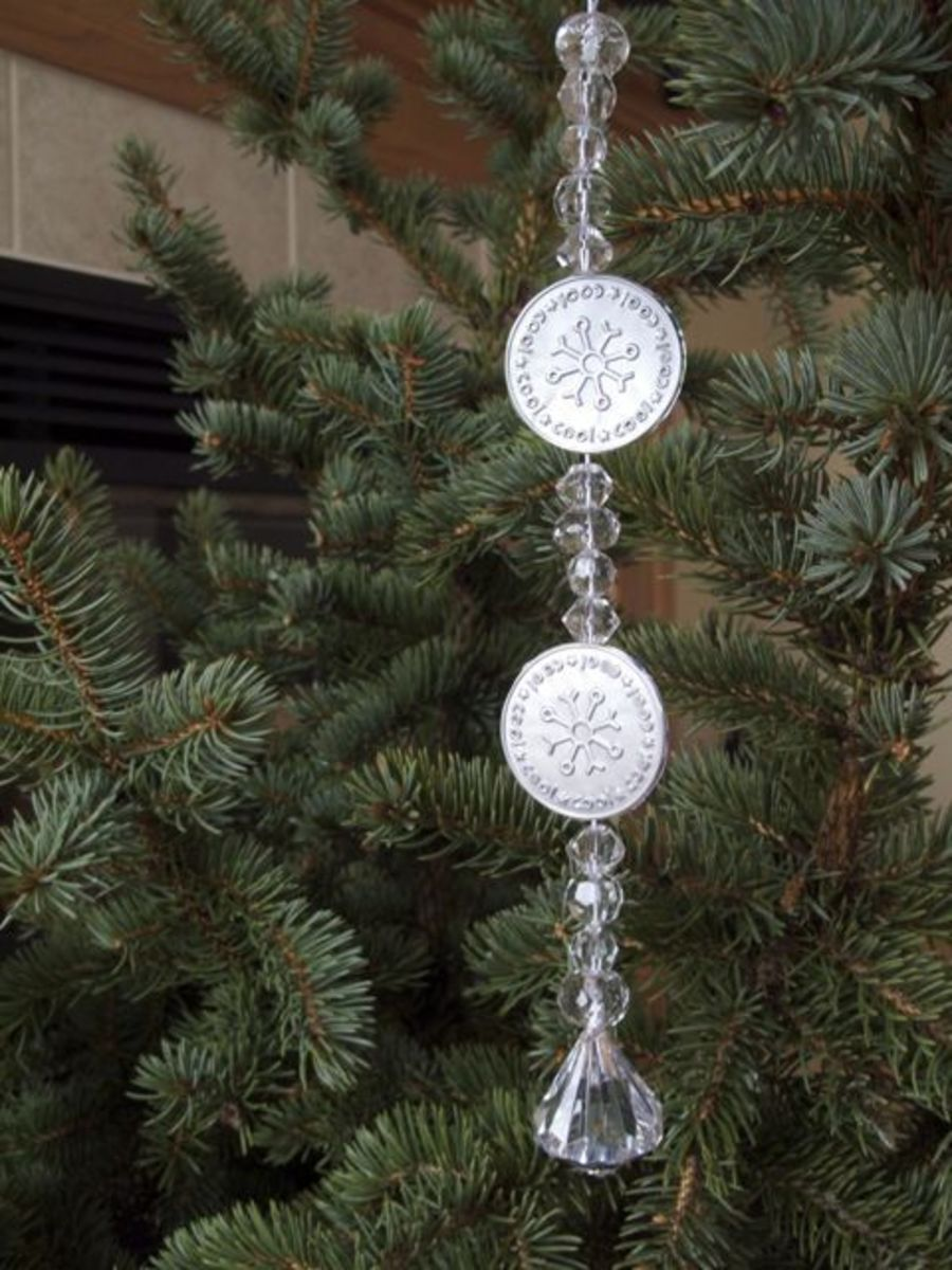 snowflake ornaments made  from recycled aluminum cans and beads