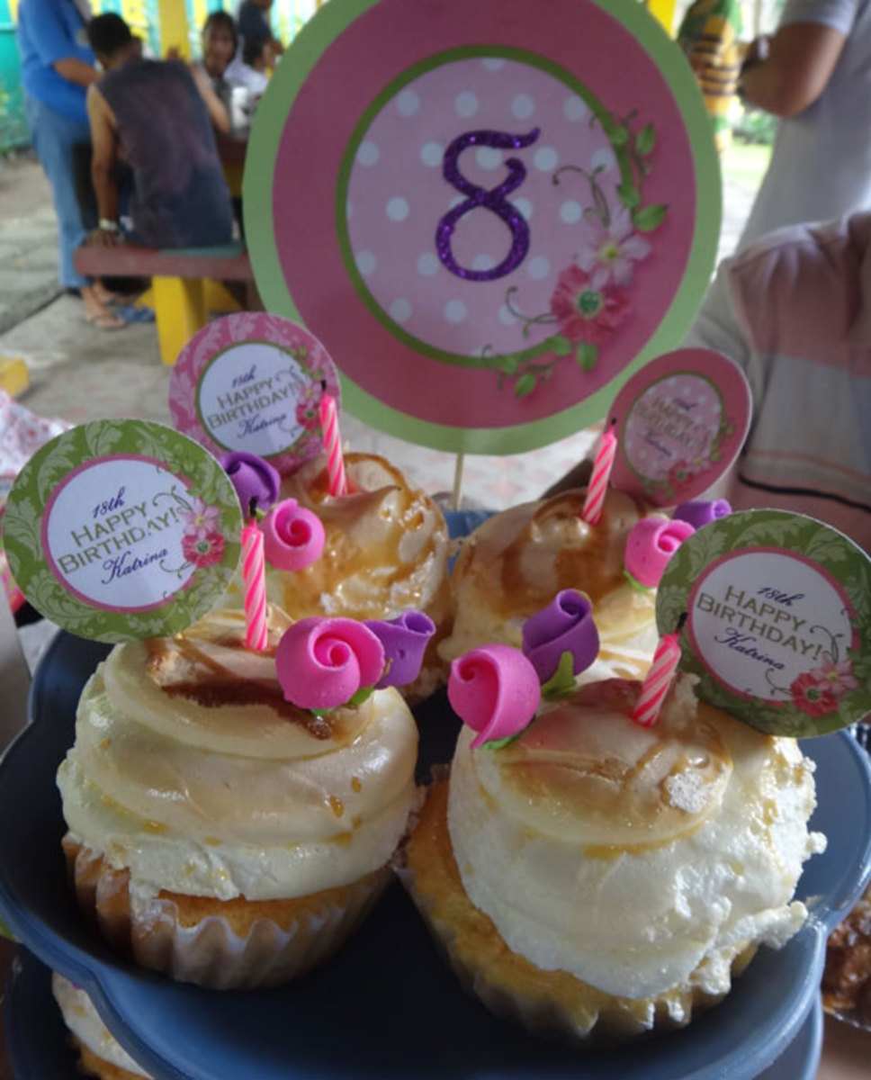 Sophie used several sizes of the cupcake topper art and then customized it in a graphics program to create toppers and table displays