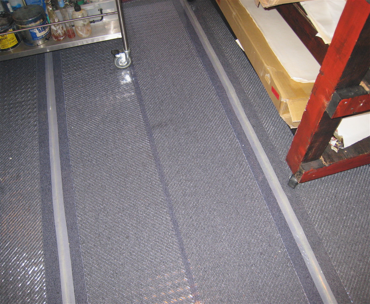 3' wide plastic floor mats with workbench and ink & paint cart