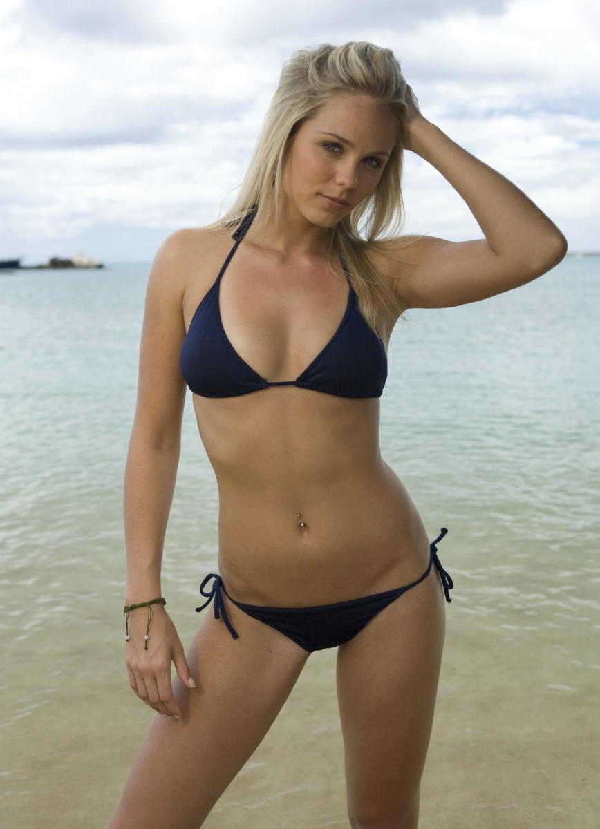 A blue-eyed blonde in a dark blue bikini.