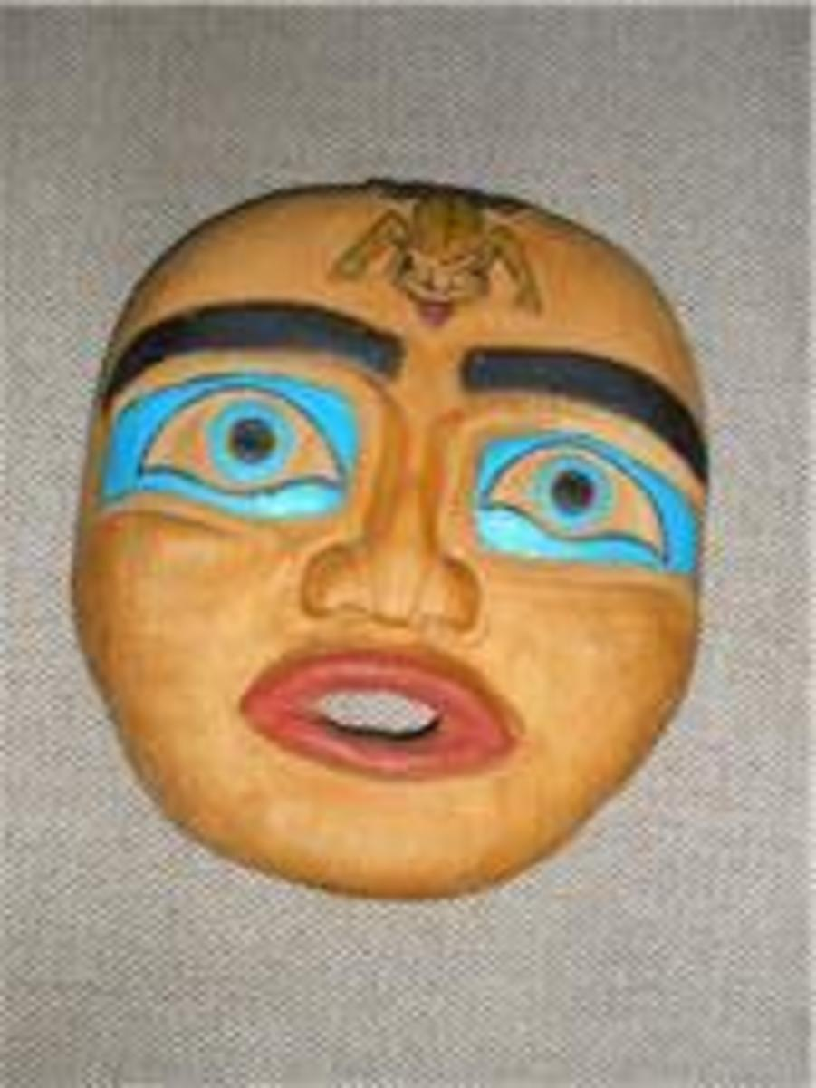 This is my very first carving, a simple flat mask I carved with teacher Mark George at Vancouver Night School. I was delighted with it at the time.It is very basic yet expressive.