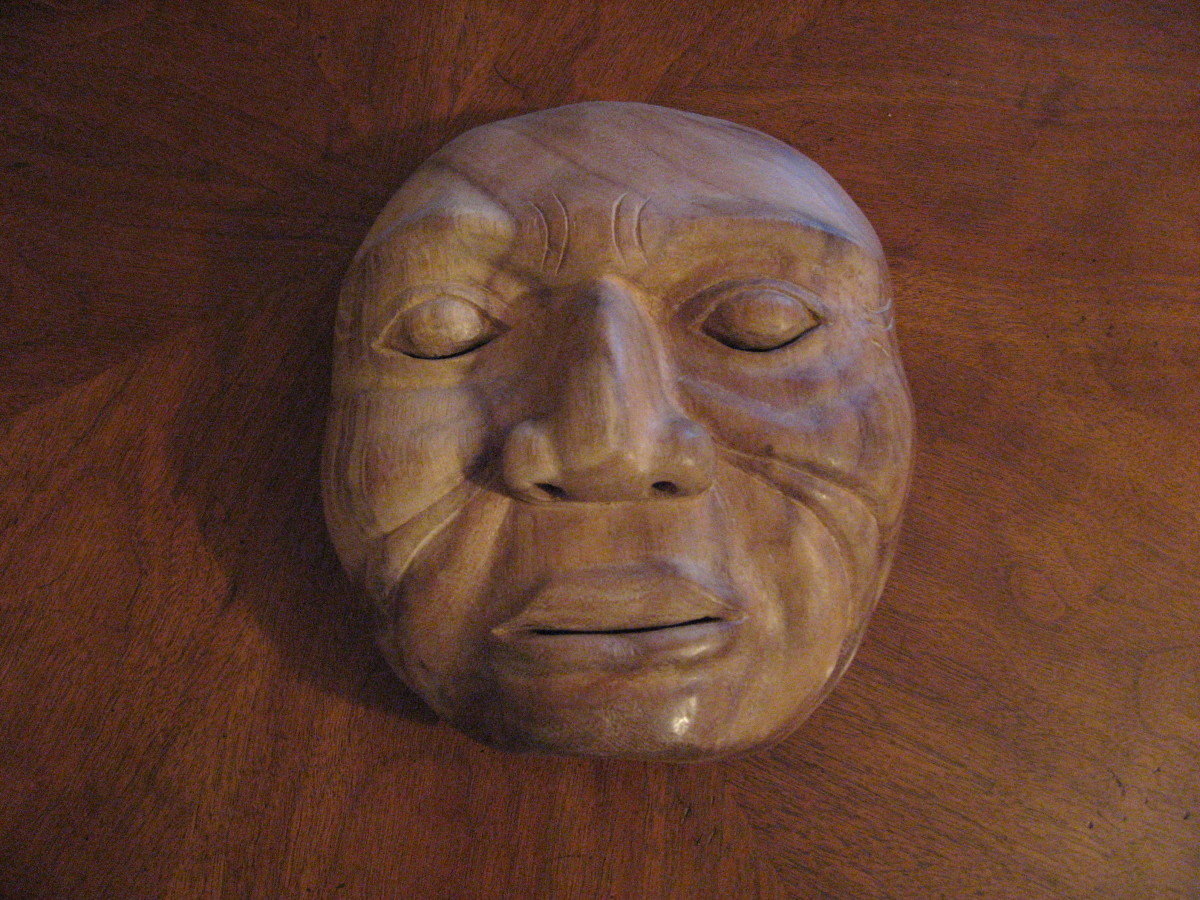 I carved this Old Man Mask with my teacher in Bali. It is thinner, more graceful and a bit more symemetrical than my first Native West Coast Mask. It makes good use of the wood grain.