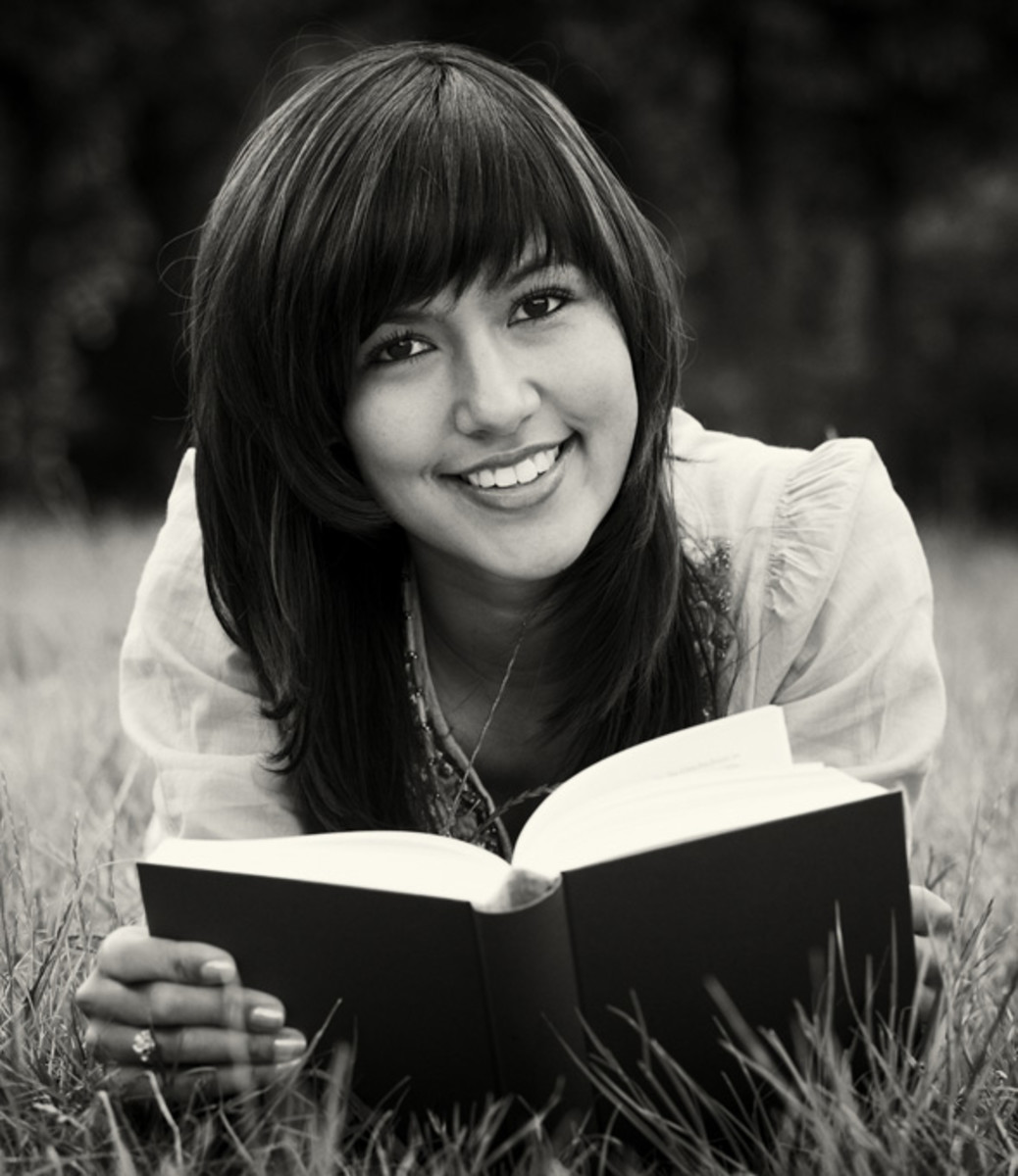 A woman models 'book reading'. She can get away with not reading this book because she has a modeling career. You, on the other hand, will actually have to read the book.