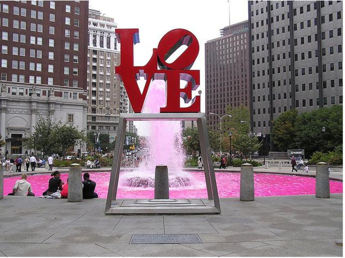 Located in Love Plaza, Philadelphia, PA. The water behind the sculpture was turned pink for breast cancer awareness month (October).