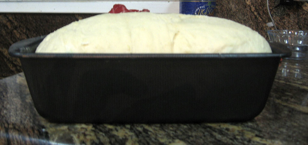 After the bread dough has raised in the loaf pan, you are ready to pop it into a  400F pre-heated oven for 14 - 19 min. Don't forget the egg wash!