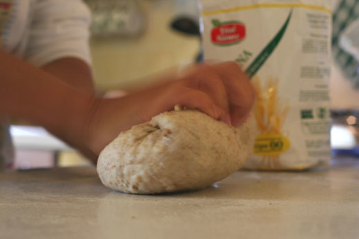 Kneading the dough stimulates the protein to enteract with the yeast; makes for a great rising homemade bread!