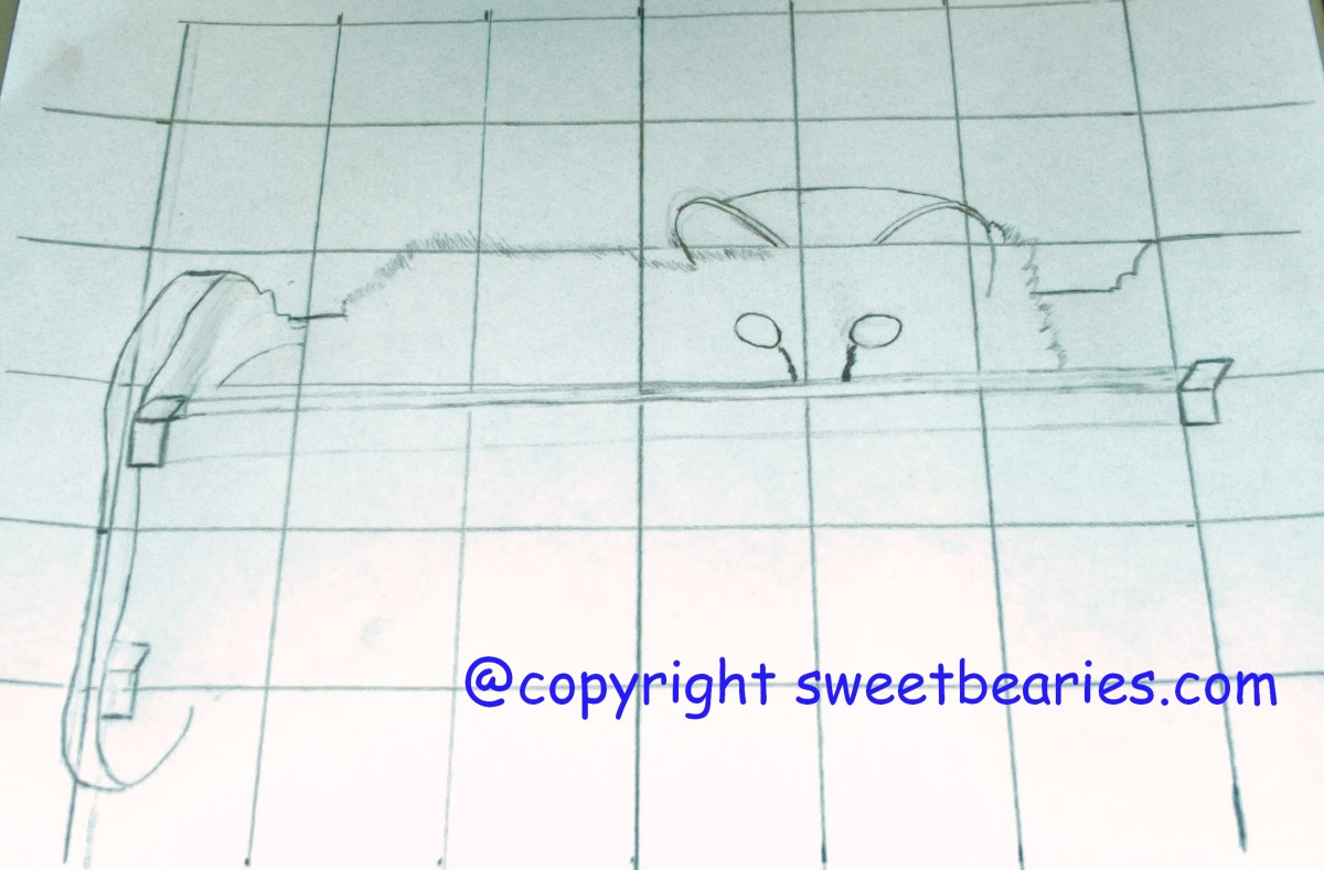 Here I am beginning to sketch the outline of the cradle Maxx is in, and the top part of his body peeking out.