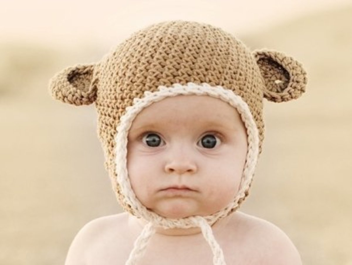 A cute variation on the crochet baby hat with ear flaps!