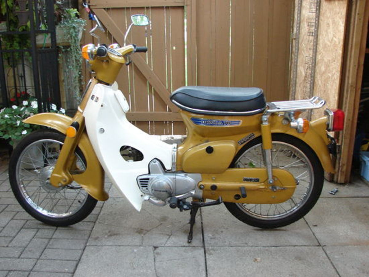 An Original Honda Cub ... over 60 million of this bike has  been produced since its introduction in 1958.  As you can see ... not much has changed and SYM has kept the retro look of this classic bike.