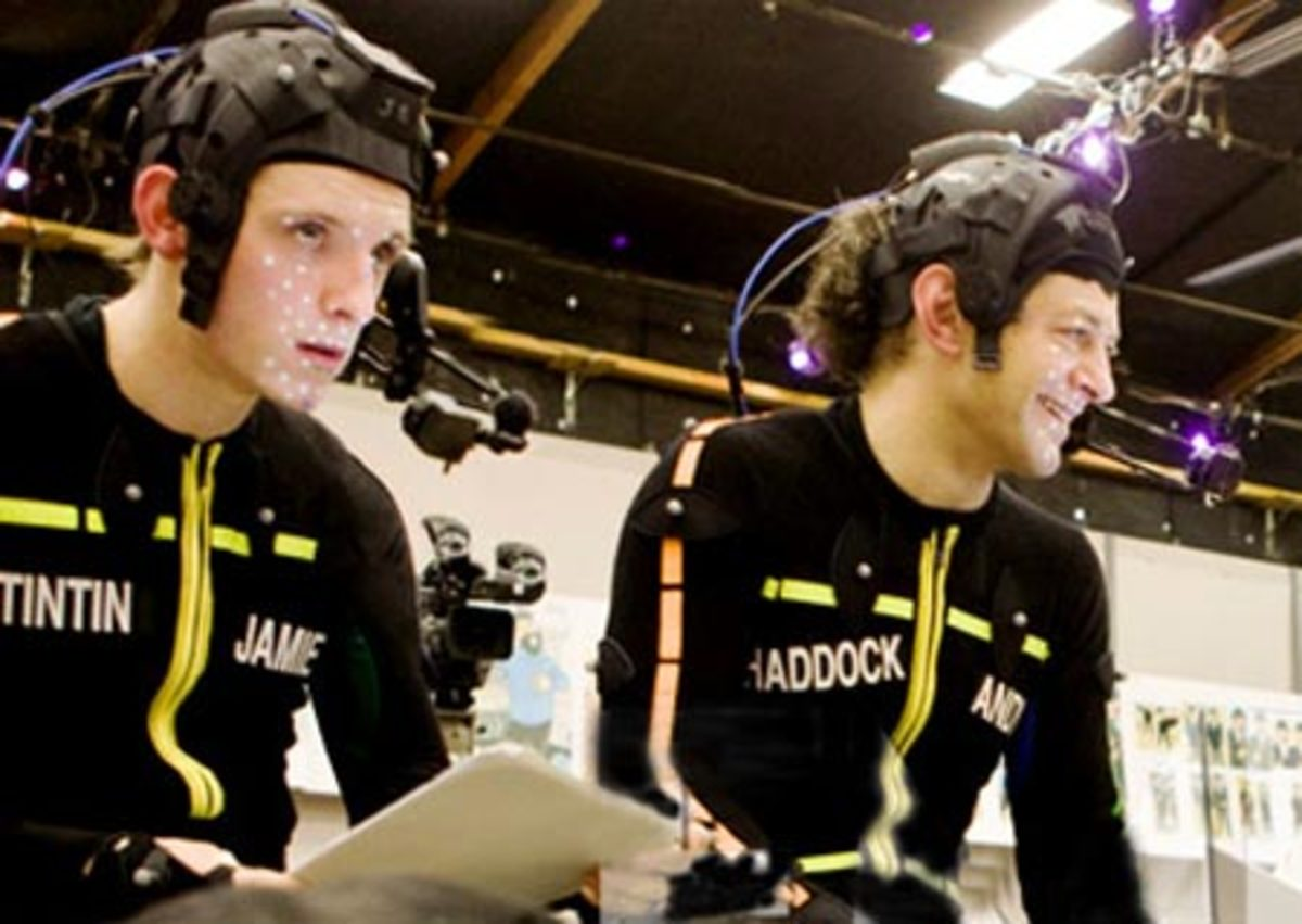 Tintin ( Jamie Bell) and Haddock ( Andy Serkis) wearing motion capture outfits.
