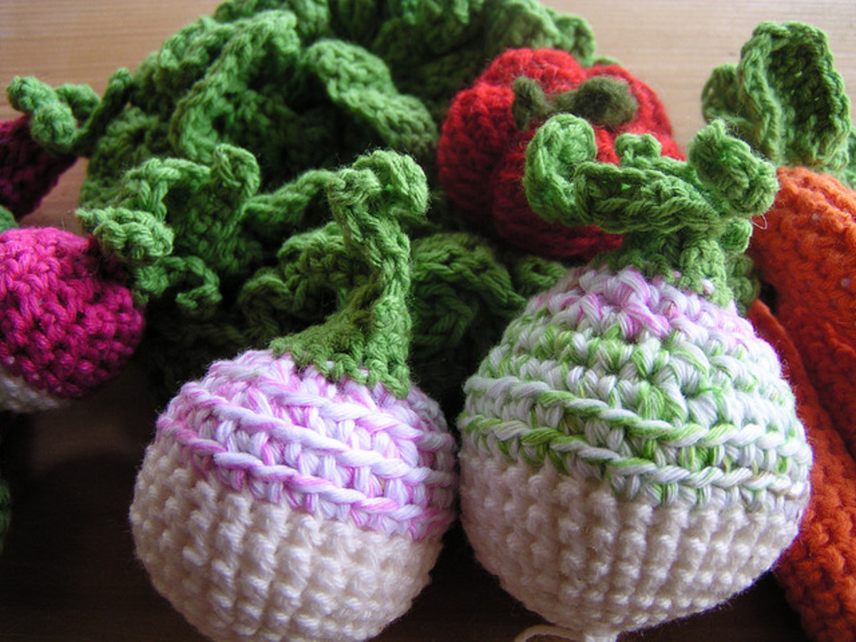 Radishes, carrots and more! I love how these look, especially the subtle coloring of the yarn.