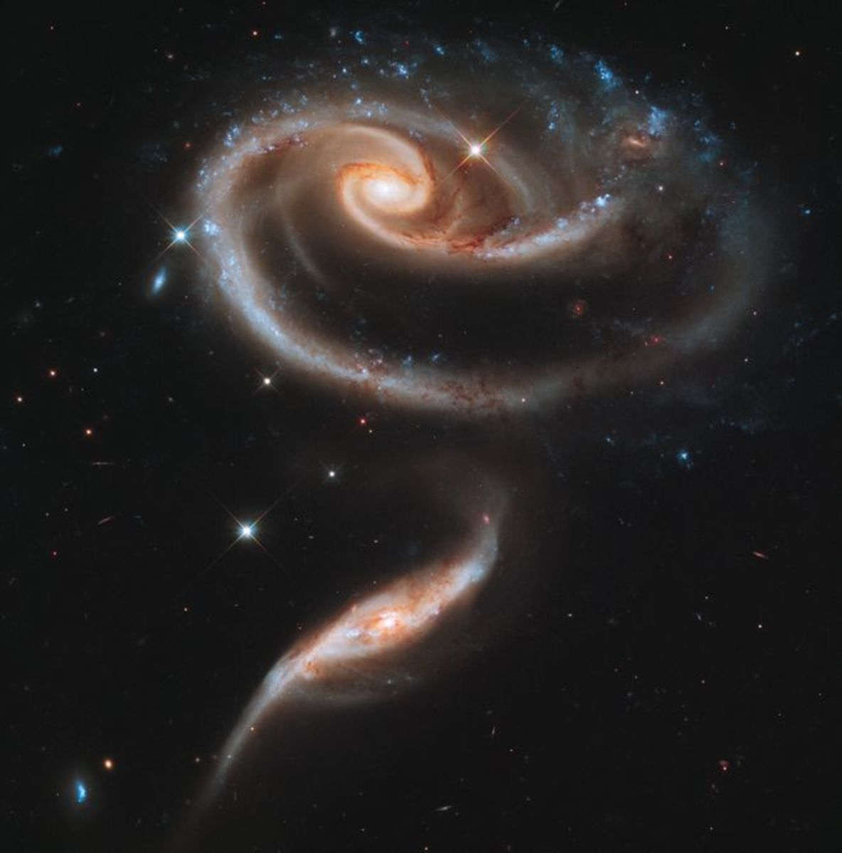 Galaxies UGC 1810 & 1813 form the rose-shaped Apr 273, icon of the 21st Anniversary of the Hubble Space Telescope deployment: 04/24/1990.