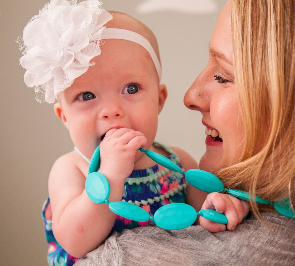 A statement necklace that also serves as a teether is a perfect baby shower gift.