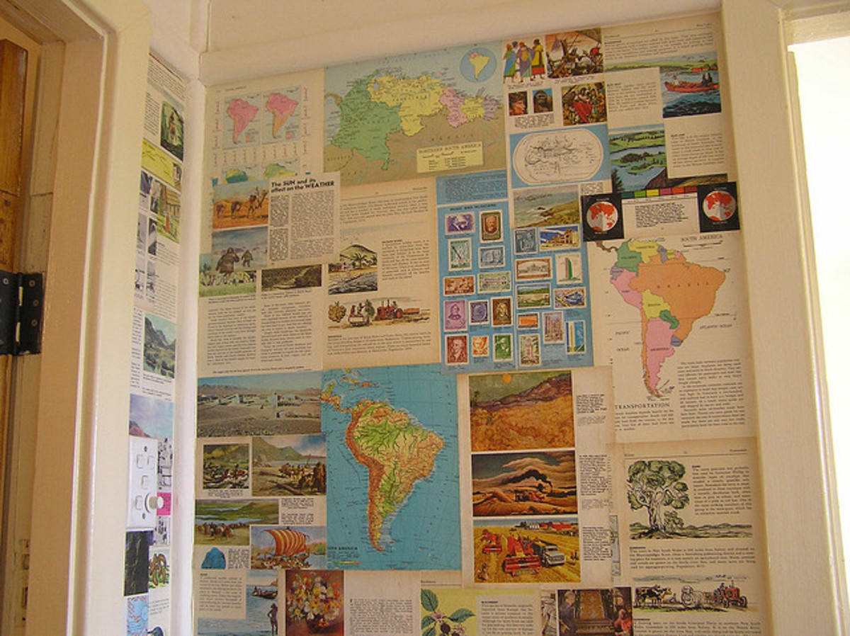 Wall covered in 1960s atlas and encyclopedia pages.