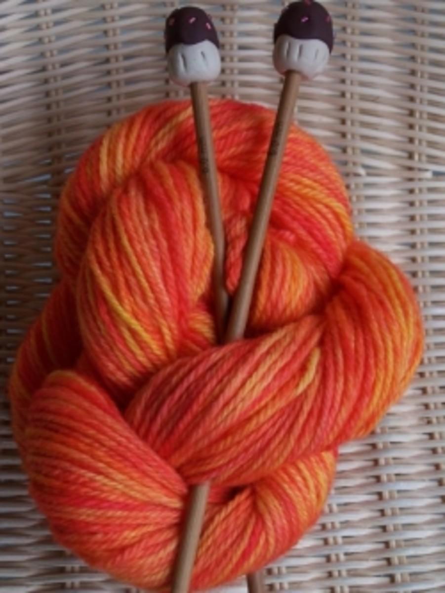 """Handmade Cupcake Knitting Needles with """"Citrus Sunrise"""" yarn"""