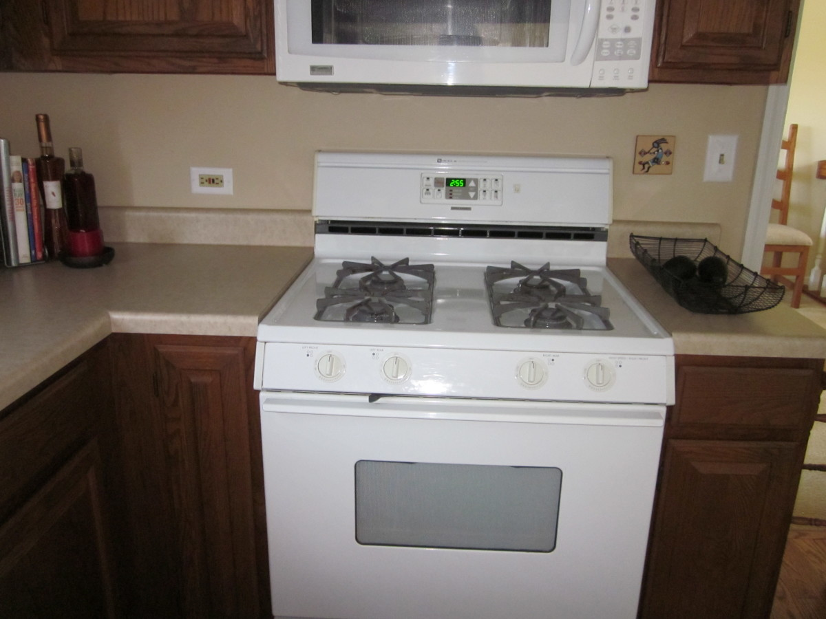 Stove remains centered under microwave even though it and the cabinet on the right of it needed to be moved slightly.