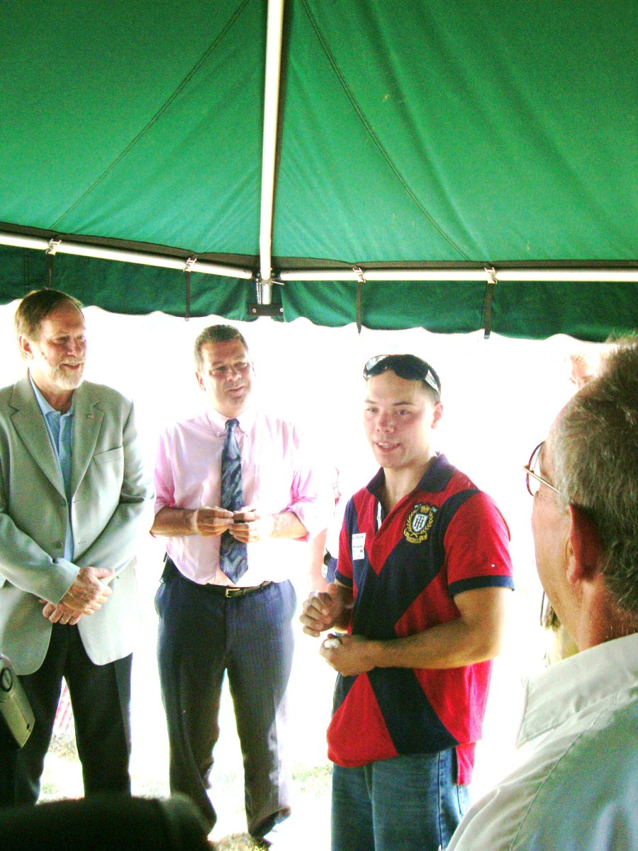 Under the tent at the Dedication for Shamus O'Brien are Mayor Philip A. Amicone, New York State Assemblyman Mike Spano and the great great grandson of Shamus O'Brien, John Hogan IV, an amateur boxer who lives in Yonkers.