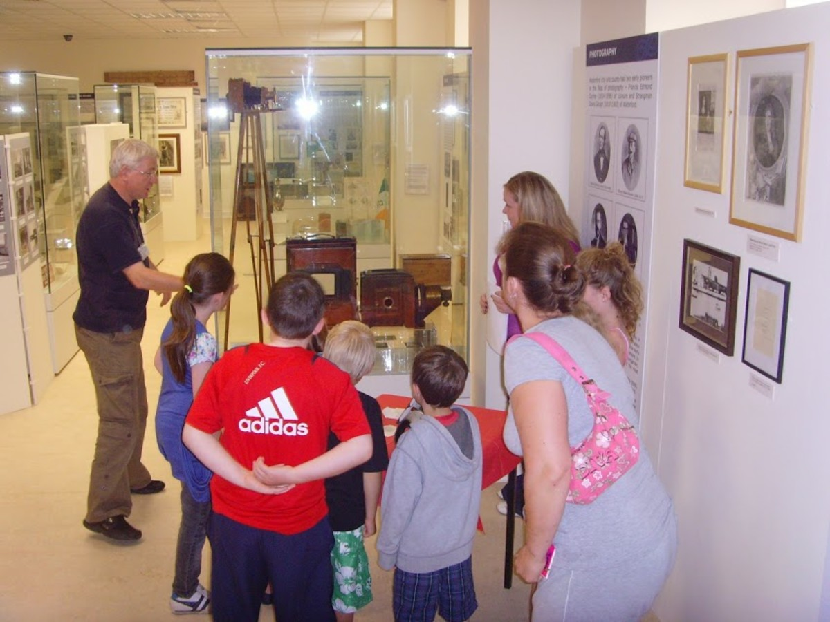 """The Sports Section of the County Waterford Museum in Dungarvan, Ireland, where """"Yonkers Favorite"""" lightweight boxing champion Shamus O'Brien (born Michael J. Hogan) is remembered. His 1913 boxing poster can be seen on the far wall in this photograph."""
