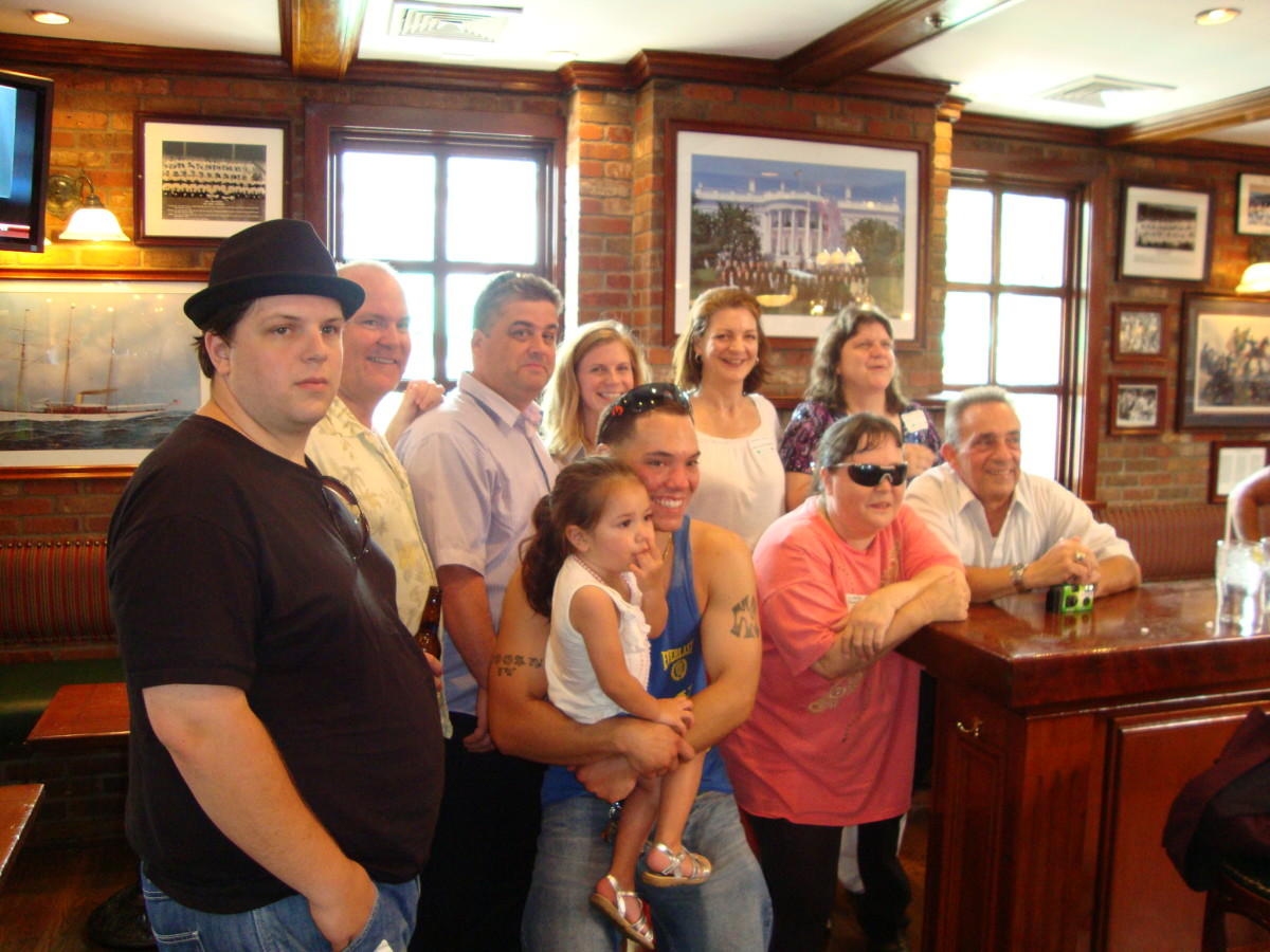 Family members get together. From left, top row, are Brandon Revels, Martin Torpey, Kieran Hogan, Natashah Revels Quinlan, Catherine Torpey, Beth Torpey Revels, and, first row, John Hogan IV (holding daughter, Valerie), Michelle Hogan, Michael Hogan