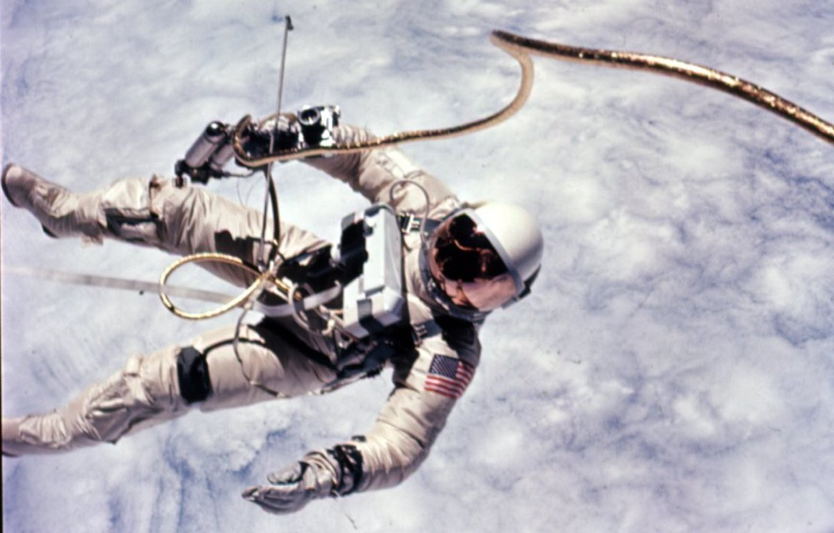 Ed White makes America's first spacewalk. The VCM is mounted on White's chest. The Hand-held Maneuvering Unit (described below) is in his right hand. Photo courtesy of NASA.