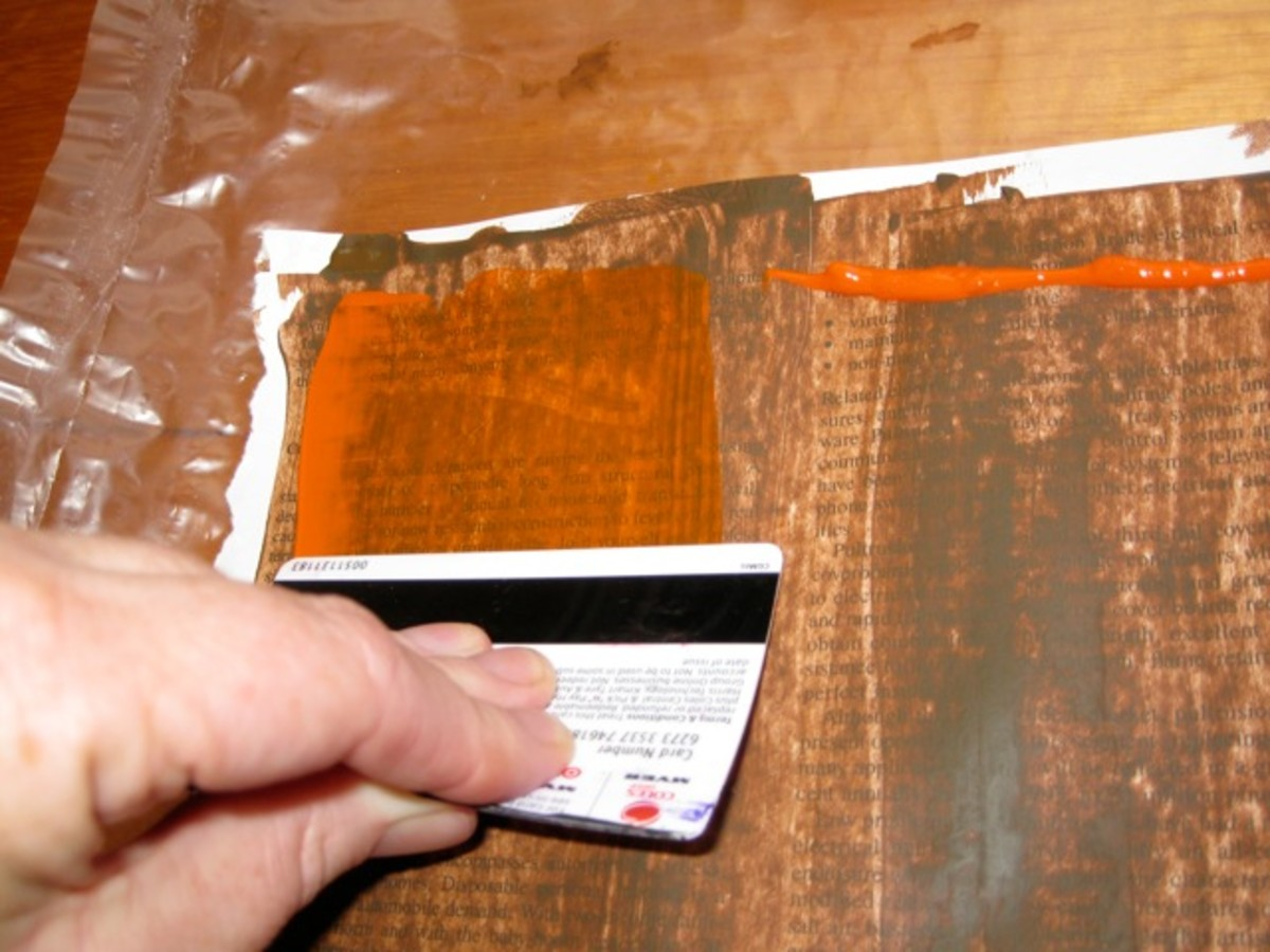 Using an old credit card to spread around two layers of acrylic paint will produce lovely results.