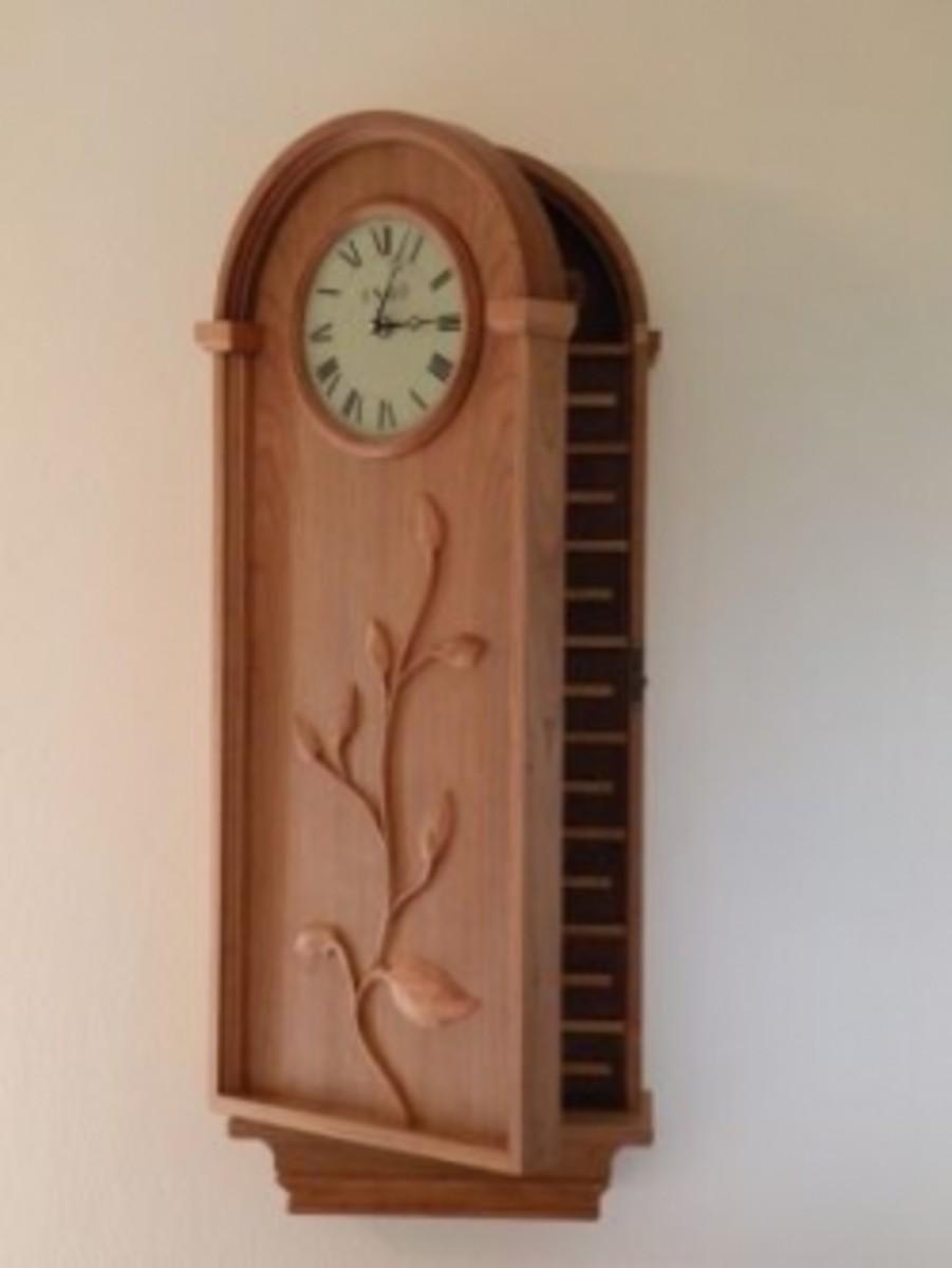 Clock with hidden door for jewelry