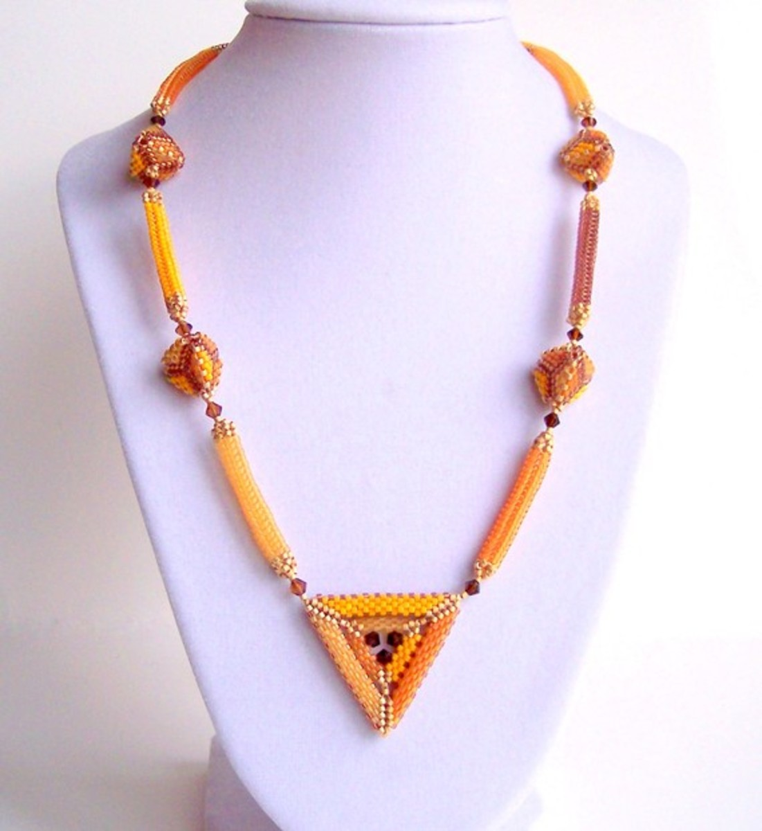 I included this example in one of my triangle hubs, but it was too perfect not to include it here, too.  I love how she combines different beaded beads for this necklace.