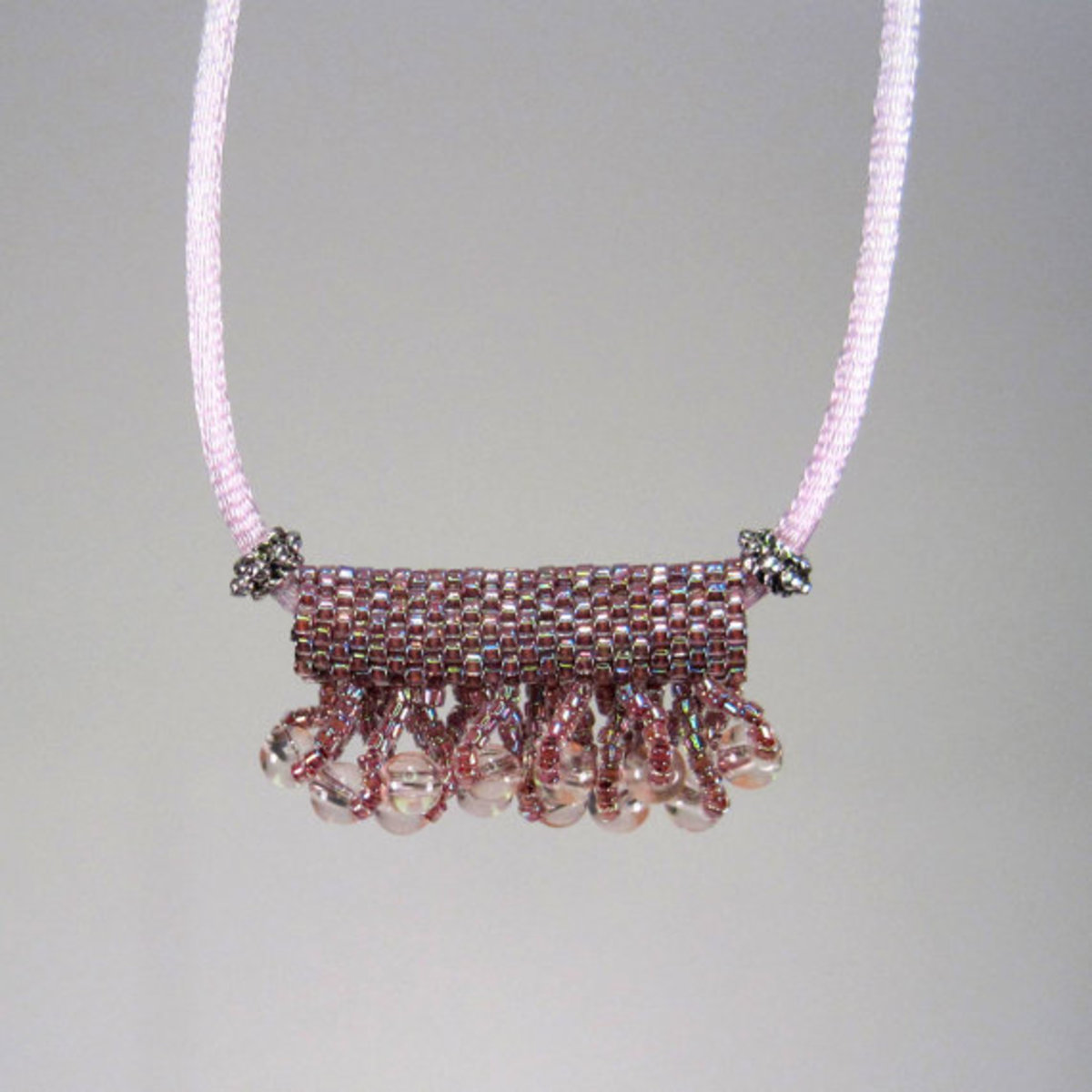 Purple Slide Necklace Peyote Tube: A beaded bead, with or without embellishment, can make a gorgeous focal for a necklace or bracelet.