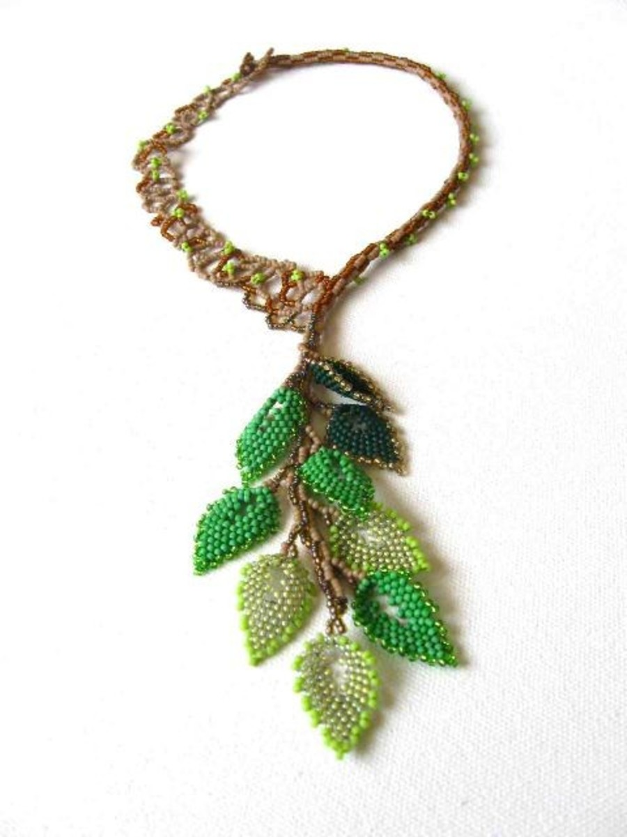 Leafing Out: Ginny also used beaded leaves to make a necklace.  I love the mix of finishes and shades for the green leaves and the natural tree structure of the necklace.