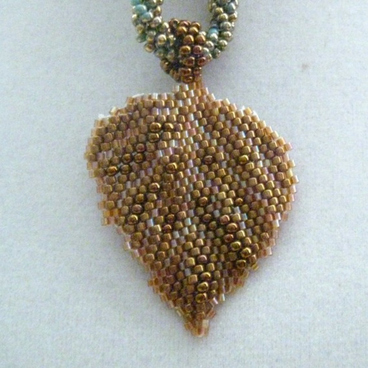 Bronze Leaf Necklace on Beaded Rope