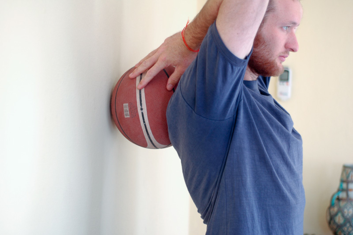 Use basket ball to massage your back.