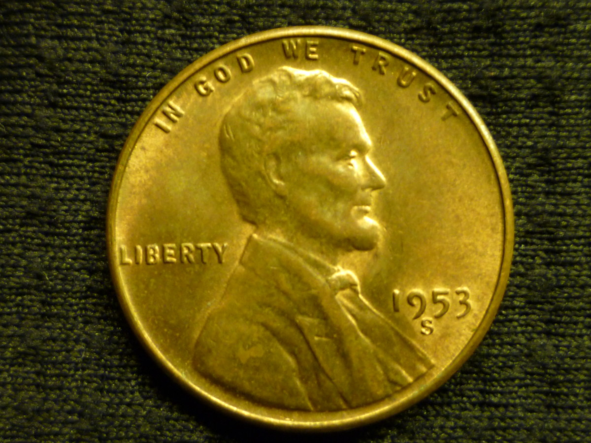 Uncirculated, Mint State Penny above and below.
