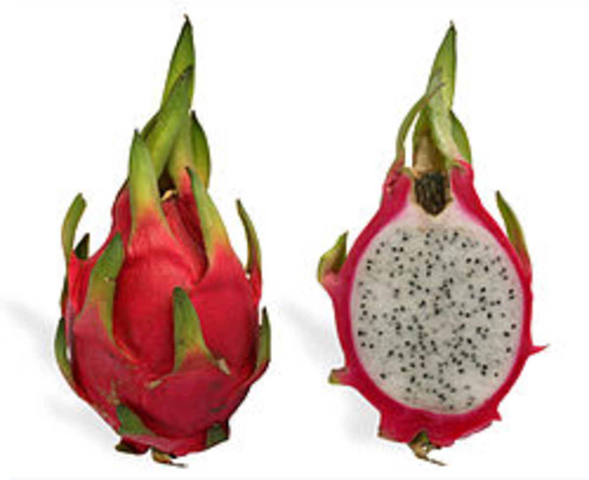 A crosssection of red skinned dragon fruit.
