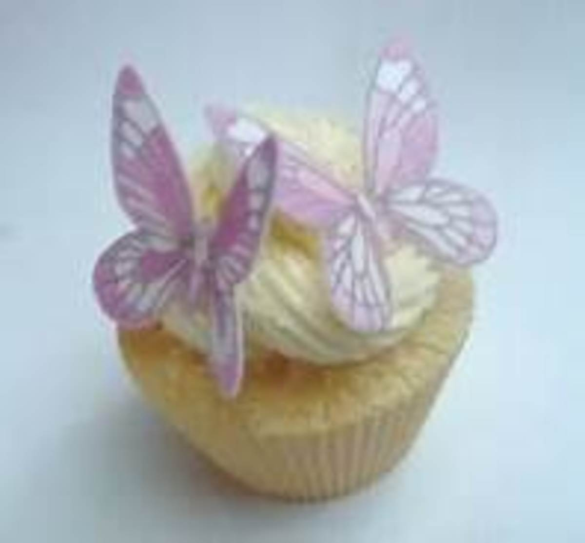 white cupcake with edible butterfly toppers